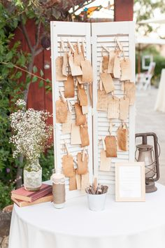 Guests wrote well wishes on tags, which were clothespinned to a vintage shutter {Photo by Shaun & Skyla Walton via Project Wedding}