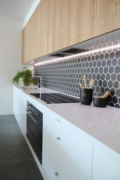 14 stunning splashbacks to bring your kitchen to life. Black hexagon tile kitchen splashback #kitchen design