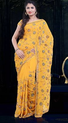 Floral Embroidered Yellow Faux Georgette Diwali Saree  ZP2604  Pretty yellow faux georgette saree which is adorned with floral stone, sequins and embroidery work all over. This attire comes with matching blouse piece.The blouse of this saree can be stitched in the maximum bust size of 42 inches.