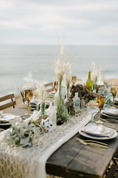 Decorative fish netting over neutral table runner... and beachy bottles...