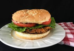 Flavorful veggie burgers topped with homemade spicy mayo