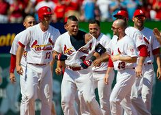 Louis Cardinals Yadier Molina is mobbed by teammates after hitting the winning RBI single against the Chicago Cubs in the ninth inning at Busch Stadium in St. Louis on May St. Louis won the game Scott Rovak/St. Louis Cardinals— at Busch Stadium. St Louis Baseball, St Louis Cardinals Baseball, Baseball Live, Baseball Cards, Cardinals Players, Cardinals Jersey, Stl Cardinals, Busch Stadium, Yadier Molina