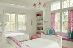 Liz Caan Interiors | White, Turquoise & Bright Pink | Chandelier w/white & pink candy stripe shades | Built-in window seat w/white piping | built-in cabinets w/pink accents | Made by Girl Gold LOVE Print | white tree branch lamp