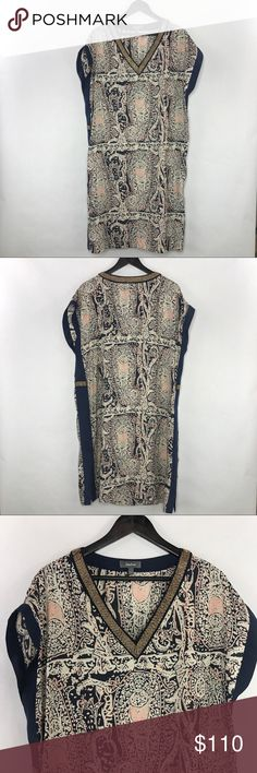 Neiman Marcus tunic dress Gorgeous tunic with beaded V-neck. Has contrast side panels with small beaded detailing, split side seam at the hem. Neiman Marcus Dresses