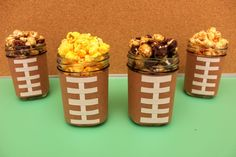 A simple idea goes a long way. Just decorate your Ball® Jars with #football themed images and fill them with your favorite snacks. #Popcorn is always a good idea.
