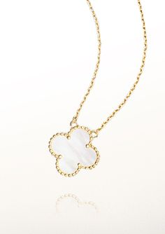 Van Cleef & Arpels' vintage Alhambra pendant, yellow gold, white-mother-of-pearl necklace—
