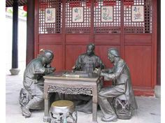A beautiful sculpture of a traditional Mahjong Game in progress.