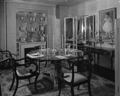 """1945 At the """"Trend House"""" installation at Marshall Field & Co., a bevy of mirrors reflect an eclectic array of furniture and accessories."""