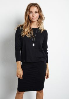 Tara long sleeve stretch jersey t shirt dress with a slim fit ruched skirt.