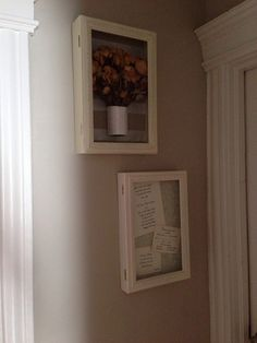 My wedding bouquet and wedding invitation in shadow boxes as keepsakes.