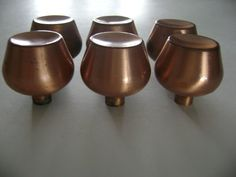 """Lot of 6 Vintage Mid-Century Drawer Knob Pulls with Copper Finish of Brass, round tulip shape, with concave """"dish"""" tops. They are not """"perfect"""" but are true mid-century modern items from the 1950s to 60s.http://www.ebay.com/itm/6-Vtg-Satin-COPPER-Plate-Cabinet-Door-Drawer-KNOBS-Pull-Concave-Mid-Century-Dish-/181657166405"""
