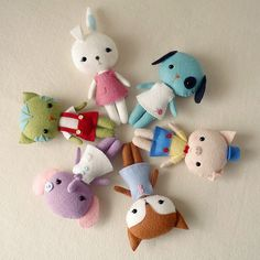Sew up these pocket sized felt animal dolls! great gift idea - only basic hand-sewing skills needed!
