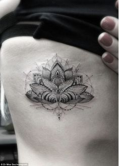 Ellie Goulding reveals intricate Lotus tattoo design etched onto her ribs | Mail Online