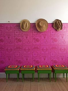 afghan stools, and hats on the wall