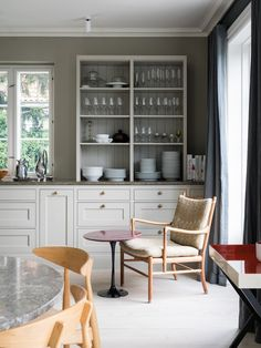 The kitchen painted in Farrow & Ball's Hardwick White Farrow And Ball Paint, Farrow Ball, Kitchen Dining, Kitchen Cabinets, Paint Shades, Danish Design, Traditional Design, China Cabinet, Paint Colors