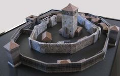 Louvaillac French Medieval Castle Paper Model - by Mythoz.Org      ==      jJul, the French designer of this model says: - This is a paper model of an early middle-age castle named Louvaillac. The place is pure fiction but would have been somewhere in Gascoigne in the South-west part of France. It is supposed to be from the13th century made over from a Gallo-roman settlement.