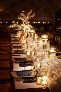 Low floral arrangements with varying candle heights and holders. metallic gold colored floating candles in the tall ones is a nice touch over plain white ones