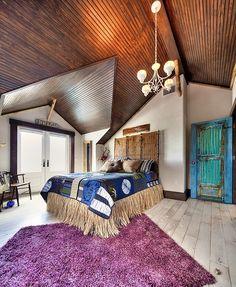 Bedroom of a trendy urban apartment that gives the classic Bohemian style a ravishing reinterpretation