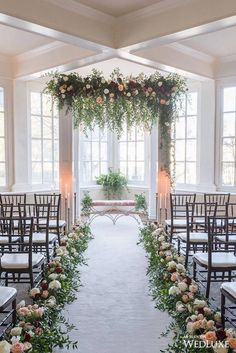 Floral installation for your wedding ceremony. Brides, you don't have to have a full flower arch to make an impact!!