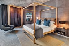 The bedrooms have timber-frame canopy beds and wardrobes with curtains instead of doors.
