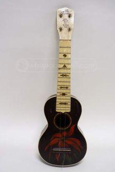 shopgoodwill.com: 1930's Gibson Poinsettia Ukulele- Rare $3001.50 on shop goodwill..... Wow