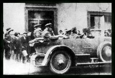 The last picture of Michael Collins, left, snapped as he and Emmet Dalton take the back seat of the touring car, departing Lee's Hotel in Bandon the day of Collins' death.