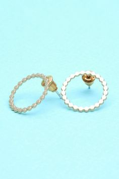 Shlomit Ofir Circle Studs in 24K Plated Gold.   http://www.shopcloakroom.com/collections/jewelry/products/olympia-fan-studs