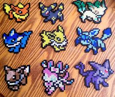 Eeveelution Perler Sprites with Pokeball Stand by GamingBeads  Starting at $6 each or $50 for all 9 sprites. Shipping is only $.99 within the U.S. International shipping available.  Custom requests accepted.