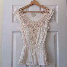 Anthropologie Deletta Crochet Tee Excellent used condition. Gorgeous cream colored tee with crochet details at neckline and hemline, elastic waist makes this top very flattering. Anthropologie Tops Tees - Short Sleeve