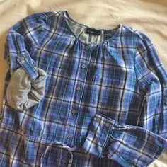 """New York and Company Plaid Tunic Really pretty periwinkle and blue plaid tunic. There is a tie at the waist so it can be cinched. Buttons all the way down. Sleeves can be worn rolled up or long. Crew neck, two pockets on chest. Worn 1 time. 100% Cotton. Measures just about 30"""" from top of shoulder to longest part of bottom. New York & Company Tops Tunics"""