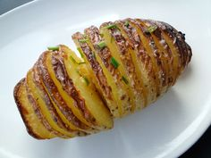 """Baked Hasselback potatoes. """"This Swedish dish takes its name from Hasselbacken, the Stockholm restaurant where it was first served."""""""