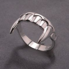 Vampire teeth ring in sterling silver. Made to order, please allow up to two weeks completion.   Please select your ring size from the drop down menu