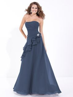 Strapless bridesmaid dress with pleated bodice with an asymmetric waist with ruffle accent and long A-line skirt.     Available in Chiffon or Organza, 3 length options and extra length, and all chiffon and organza colors.