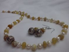 Yellow opal and pearls 65€ More on http://nakitkamala.wix.com/europe