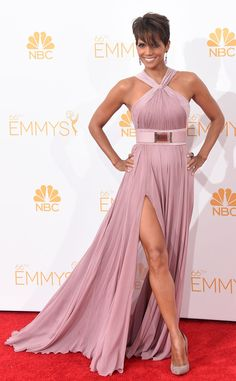 Halle Berry stuns at the 2014 Emmys in a flowing mauve gown with a cinched waist.