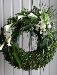 boxwood wreath with white flowers
