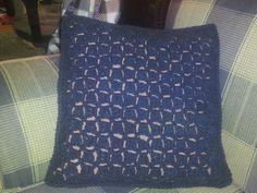 crocheted throw pillow