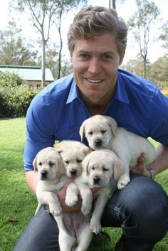 Dr Chris with cute pups - I want one! and maybe one of those pups. Dr Chris Brown, Hot Doctor, Andy Garcia, Liam Hemsworth, Pet Birds, Cubs, Cute Puppies, Labrador Retriever, Creatures
