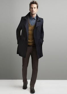 navy military jacket with epaulets, olive deep v-neck sewater, glaucous shirt, brown pants, black boots