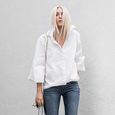 Elevate your everyday white shirt with a dramatic bishop sleeve   @FIGTNY wears the Adagio Shirt now available online