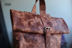 A close up on the Rollitbag classic in Terracotta.  Handmade in our own atelier in The Netherlands. Made from sustainable produced leather.  Go everywhere with the perfect accessory for everyday.  www.meesdesign.com () enjoy free ww shipping () Terracotta, Messenger Bag, Satchel, Classic, Netherlands, Leather, Handmade, Bags, Accessories