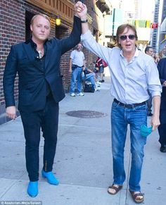 That's my boy!!!  James Paul McCartney & his son, on the left, James McCartney ..  check the shoes!