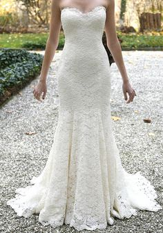 This is a brand new, never worn Vineyard Lace wedding dress from Romona Keveza's Spring 2015 collection. It has gorgeous and truly unique lace detail with a very flattering fit. The dress has a slight