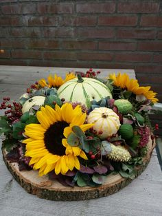 Love this simple centerpiece - we source local grown gourds from my families farm and local grown sunflowers #fantasyflowers