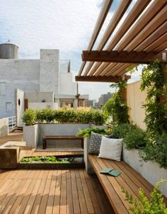 decking seating and stone walls with integrated planters: