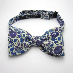 sweet little bow tie with blue and purple floral pattern