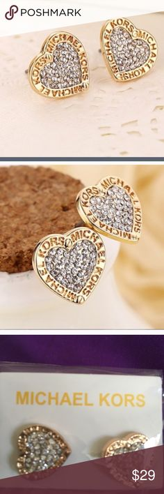 MK diamond heart earrings ❤️❤️❤️❤️ MK diamond heart earrings ❤️❤️❤️❤️. You will love the sparkle of these! Michael Kors name around the shape of the heart. I also have these in rose gold & dangle MK earrings as well Michael Kors Jewelry Earrings