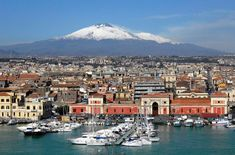 Catania - Sicily - The image of the city is of course bound to the volcano towering over it, the Etna, which lava was used by the century architect Giovan Battista Vaccarini to rebuild the majority of houses destroyed Catania Italia, Catania Sicily, Sicily Italy, Toscana Italy, Sorrento Italy, Naples Italy, Venice Italy, Cinque Terre, Sicily Travel
