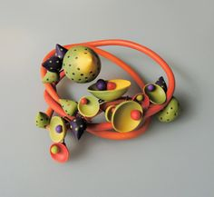 Necklace |  Chama Navarro.   The flexibility of polymer covered wire allows the pieces to be worn in different ways – short, long, twisted or winding down the neck.  http://www.flickr.com/photos/chamari/sets/72157623586312018/