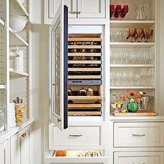 Beverage Cabinets | A wine cooler, relocated from elsewhere in the house and outfitted with new beverage drawers on the bottom, turns part of this pantry into a drink station.